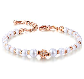 Armband med små pärlor och Austrian Crystals samt i 18 K Guldplätering