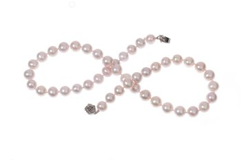 Freshwater pearl necklace with Champagne colour pearls set with silver clasp