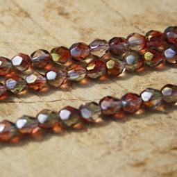 Fasetterade crystal glaspärlor med coating i orange/lila , 6 mm.