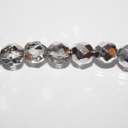Fasetter i silver och crystal, 8 mm. Ca 12 cm sträng.