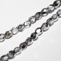 Fasetterade pärlor i mörk crystal med silver, 4 mm.