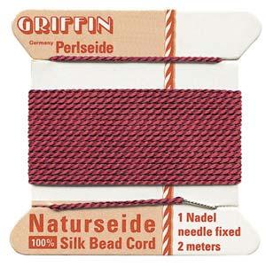 Rött pärlsilke med nål, 0,6 mm.