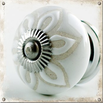 White ceramic cabinet knob with floral pattern