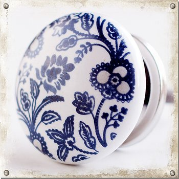 White knob in porcelain with blue wildflowers