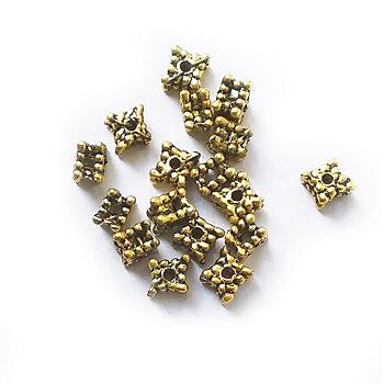 Sirlig kub guld