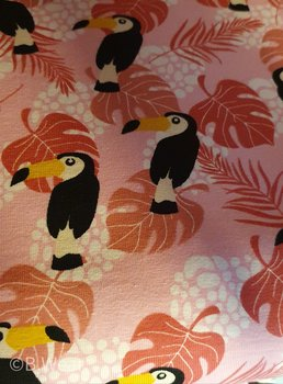 Pink cottontricot with toucans