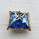 Glassten med infattning  - Guldfärgad med blå sten 15mm 1 styck