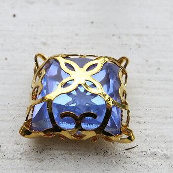 Glassten med infattning  - Guldfärgad med lila sten 15mm 1 styck