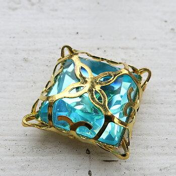 Glassten med infattning  - Guldfärgad med turkos sten 15mm 1 styck