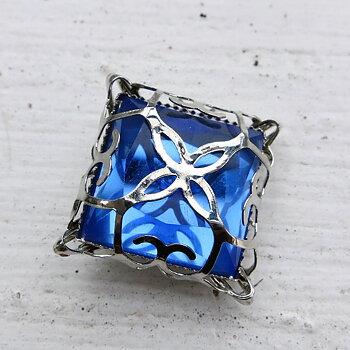 Glassten med infattning  - Silverfärgad med blå sten 15mm 1 styck