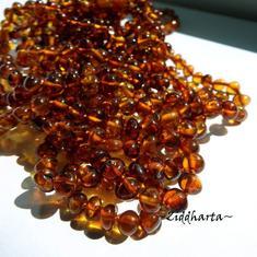 Rundad Semi-rund Bärnsten / Amber: 10st pärlor - Dark Cognac - Grade A - ca 6mm