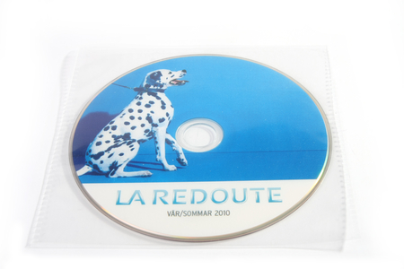 CD with print in plastic sleeve interloc