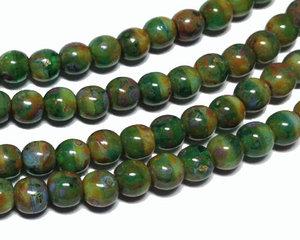 Runda pärlor i blandade gröna och bruna färger, 4 mm. En sträng.
