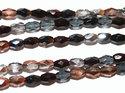 Fasetterad tjeckisk oval fire polish pärla i mixade metall och mörka färger, 4*6 mm. En sträng.