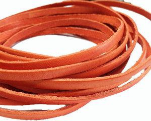 Orange platt brett läder, 5 mm brett. Per 20 cm.