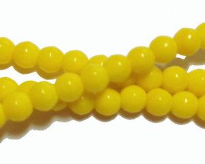 Opaka gula runda glaspärlor, 4 mm. En sträng
