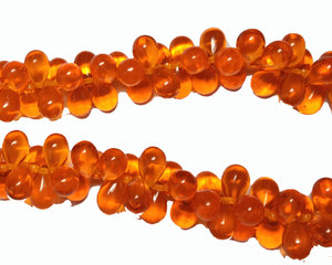Orange drop pärlor, 9*6 mm. En 12 cm sträng.