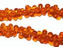Orange drop pärlor, 9*6 mm. En 12 cm sträng.