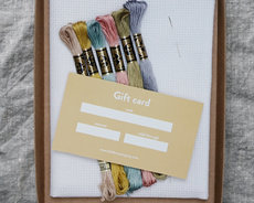 Start-kit including floss, fabric, needle and gift card