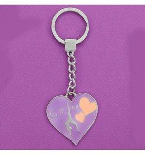 Gymnastnyckelring med hjärta i rosa eller lila