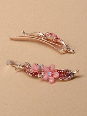 Hårspänne med kristaller och blomma i rosa eller lila