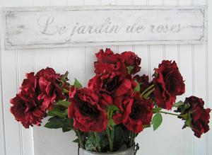 Skylt med fransk text Le jardin de roses
