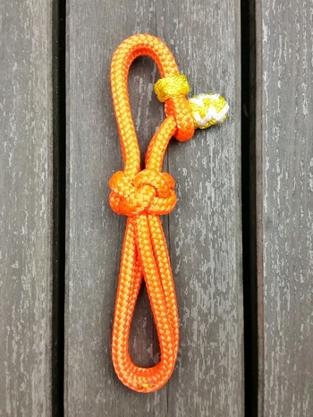 Lead rope connector with decorative end knot for neck ropes
