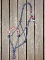 Braided rope halter with knot adjustment