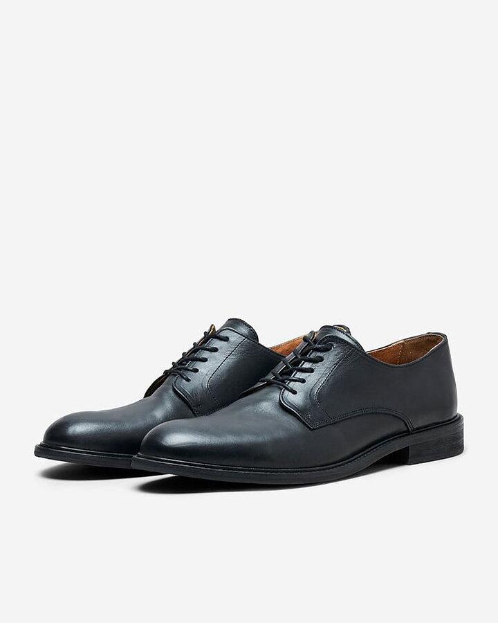 svarta skor med svart sula