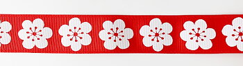 Printed ribbon white flowers on red 22mm
