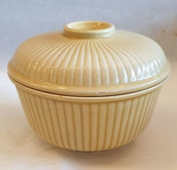 Yellow sugar bowl with lid