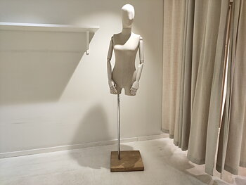 Fabric-covered mannequins with articulated arms