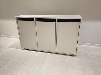 Storage cabinets with folding doors