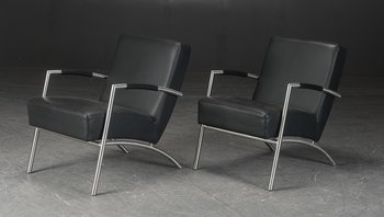A pair of armchairs, black leather with leather armrests