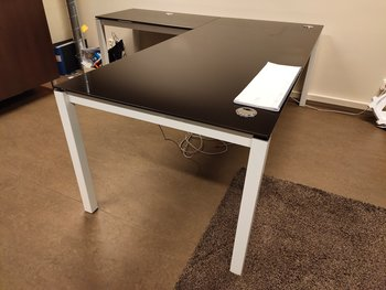 Corner desk in black glass with cable holes
