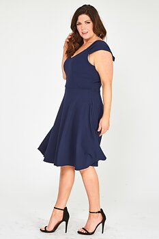 Vippig klänning med rosett, marinblå