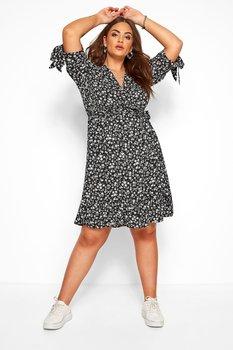 Småblommig omlottklänning med volang i nederkant, svartvit