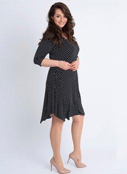 Prickig v-ringad klänning med trekvartsärm