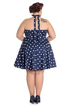 Prickig vippig klänning på marinblå botten
