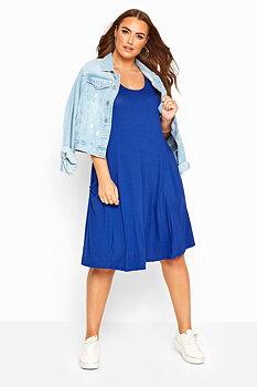 Ärmlös swingklänning med fickor, kornblå