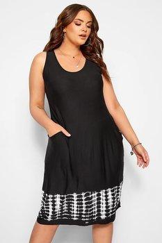 Swingklänning med fickor och batiktryck, svart
