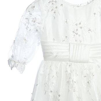 Dopklänning med paljettprydd spets