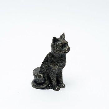 Krukfötter i brons designad som en sittande katt
